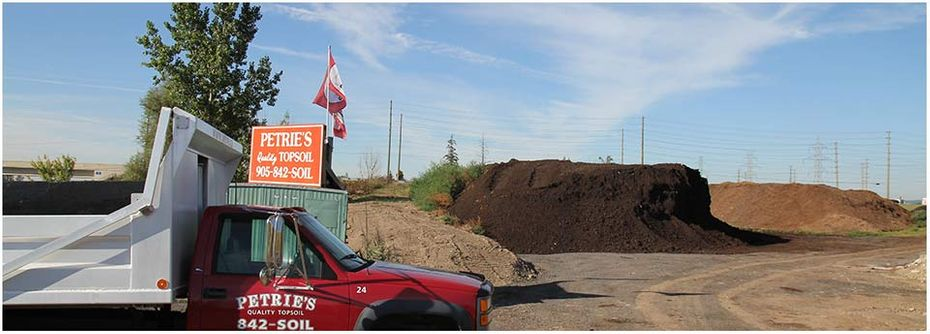 Petrie's Quality Topsoil Ltd. | work site; truck in Oakville