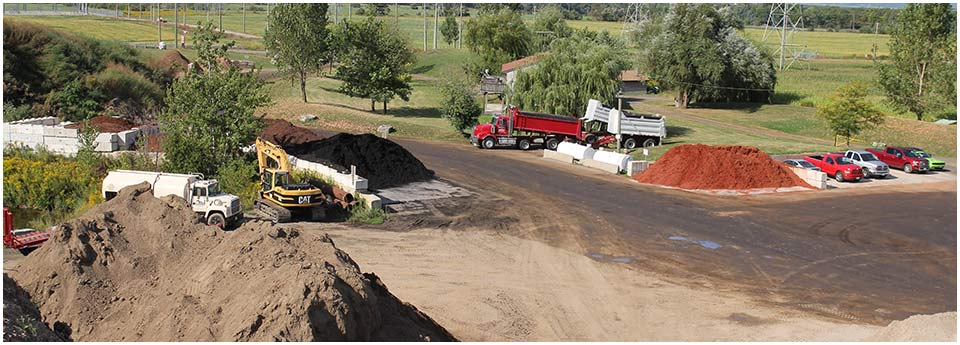 Petrie's Quality Topsoil Ltd. | work site; trucks 1
