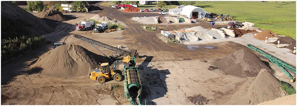 Petrie's Quality Topsoil Ltd. | work site; trucks 3